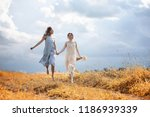 two beautiful girls in dresses... | Shutterstock . vector #1186939339