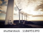 windmills for electric power... | Shutterstock . vector #1186951393