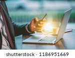 a business guy in a cafe uses a ... | Shutterstock . vector #1186951669