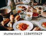friends having a pasta dinner... | Shutterstock . vector #1186955629