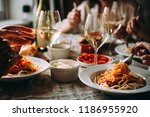 friends having a pasta dinner... | Shutterstock . vector #1186955920