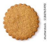 Small photo of Single round gingerbread biscuit isolated on white from above. Serrated edge.