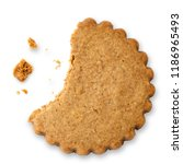 Small photo of Partially eaten round gingerbread biscuit isolated on white from above. Serrated edge.