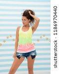 hipster girl showing her split...   Shutterstock . vector #1186970440