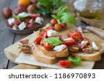 italian bruschetta with chopped ... | Shutterstock . vector #1186970893