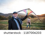 carefree senior couple flying a ... | Shutterstock . vector #1187006203