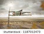 funny man gets blown away by a... | Shutterstock . vector #1187012473