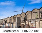 curved roof warehouses along ... | Shutterstock . vector #1187014180