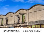 curved roof warehouses along ... | Shutterstock . vector #1187014189