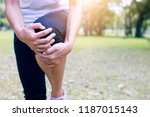 sport woman  runner has knee... | Shutterstock . vector #1187015143