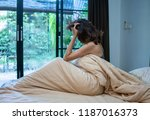 depressed asian woman sitting... | Shutterstock . vector #1187016373