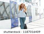 portrait of happy woman walking ... | Shutterstock . vector #1187016409