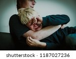 father comforting stressed... | Shutterstock . vector #1187027236