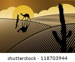 Silhouette Of A Man And Camel...