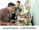 friends cooking together in... | Shutterstock . vector #1187069083