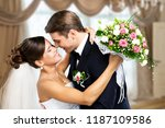 happy just married young couple | Shutterstock . vector #1187109586