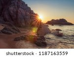 rocky beach at sunrise with... | Shutterstock . vector #1187163559