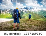 hiking trail with tourists in... | Shutterstock . vector #1187169160
