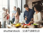 home party. multiethnic couple... | Shutterstock . vector #1187188513