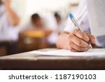 school students taking exam... | Shutterstock . vector #1187190103