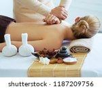 masseur doing massage on woman... | Shutterstock . vector #1187209756