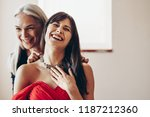 woman laughing in happiness... | Shutterstock . vector #1187212360