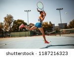 female tennis player hits the... | Shutterstock . vector #1187216323