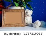 empty photo frame and white... | Shutterstock . vector #1187219086