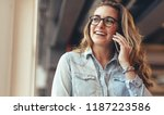 smiling businesswoman talking... | Shutterstock . vector #1187223586