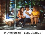 group of teenagers on the street | Shutterstock . vector #1187223823