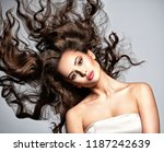 beautiful  woman with long... | Shutterstock . vector #1187242639
