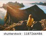 woman standing alone in sunset... | Shutterstock . vector #1187266486