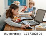 girl using a laptop while... | Shutterstock . vector #1187282503