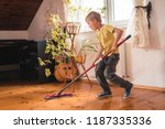 A 6 Year Old Boy Cleaning The...