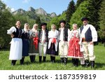 people in traditional clothes... | Shutterstock . vector #1187359819