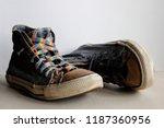 pair of worn vintage blue... | Shutterstock . vector #1187360956