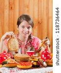 Girl in traditional  clothes eating pancake during  Pancake Week - stock photo