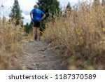 hiker backpacking on a grassy... | Shutterstock . vector #1187370589
