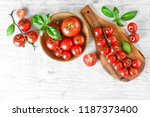 fresh red variety of tomatoes... | Shutterstock . vector #1187373400