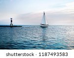 Yacht And Lighthouse At The...