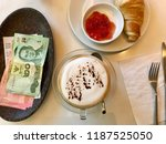 coffee cup with butter...   Shutterstock . vector #1187525050