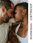 gay couple cuddling in bed | Shutterstock . vector #1187582329