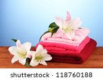 stack of towels with pink lily... | Shutterstock . vector #118760188