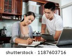 young married couple writing... | Shutterstock . vector #1187603716