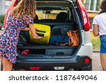 two woman packing luggage in... | Shutterstock . vector #1187649046