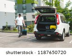 man pull suitcase with wheels... | Shutterstock . vector #1187650720