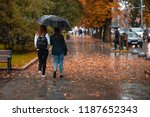 two woman walking under one... | Shutterstock . vector #1187652343