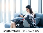 asian women sit on sofa  check... | Shutterstock . vector #1187674129