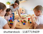 preschool teacher with children ... | Shutterstock . vector #1187719609