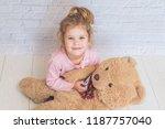 the girl  child measures the... | Shutterstock . vector #1187757040